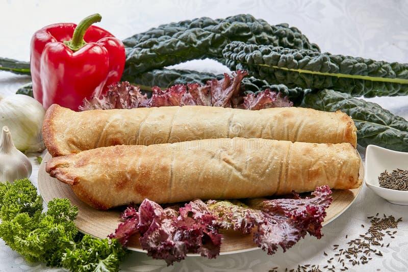 Turkisk pizza roulett fotografering för bildbyråer