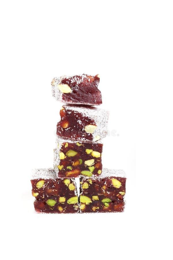 Turkiska sötsaker - fröjdrahat-lokum royaltyfria foton