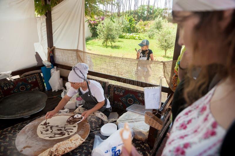 Woman cooking cakes gozleme. Hotel in Turkey royalty free stock photos