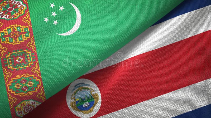 Turkmenistan and Costa Rica two flags textile cloth, fabric texture royalty free illustration
