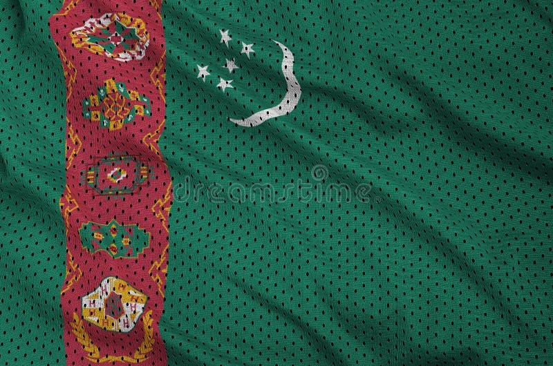 Turkmenistan flagga som skrivs ut på ett ingrepp f för polyesternylonsportswear arkivfoton