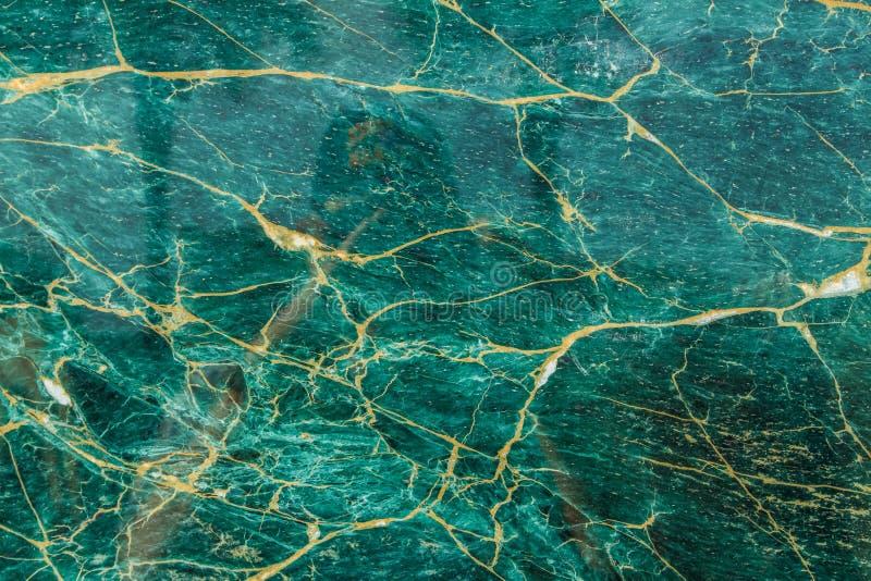 Turkoois en Goud Opgepoetst Graniet stock afbeelding