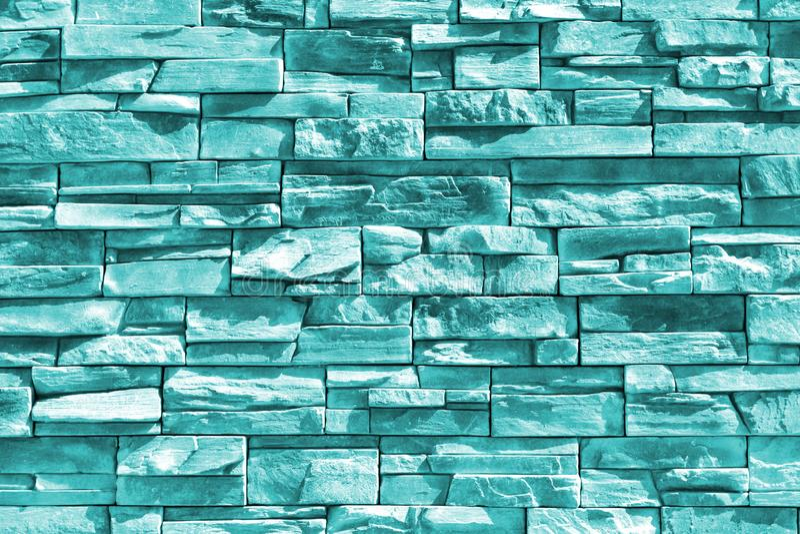 Turkosblå inre klippt stenvägg royaltyfria bilder