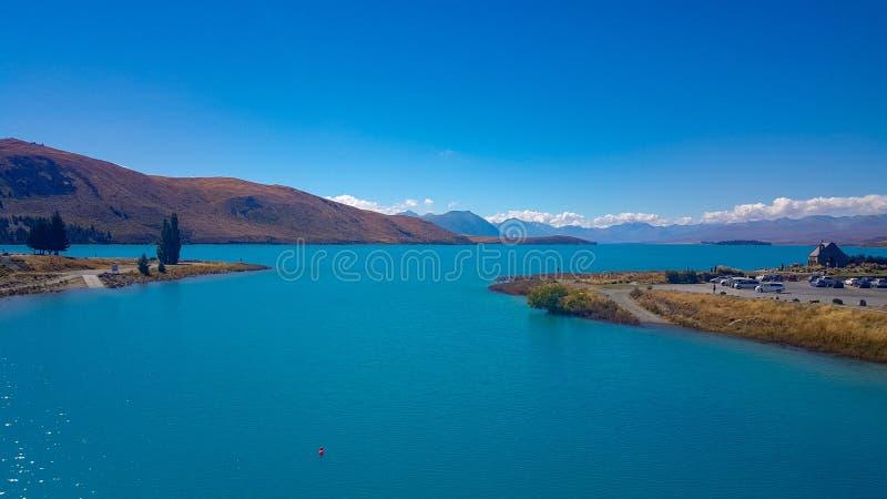 Turkosvatten på sjön Tekapo fotografering för bildbyråer