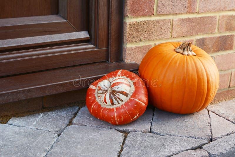 Turks Turban gourd and an orange pumpkin as autumnal decoration stock photos