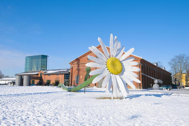 Giant chamomile flower against the background of the `Forum Marinum` exhibition center, winter day. Turku, Finland. TURKU, FINLAND - FEBRUARY 23, 2018: Giant royalty free stock photography