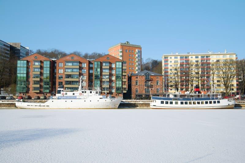 Two ships hibernate at the city waterfront. Turku, Finland. TURKU, FINLAND - FEBRUARY 23, 2018: Two ships hibernate at the city waterfront stock images