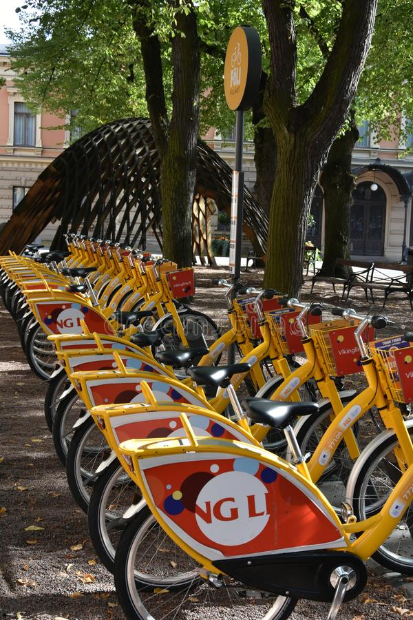 Turku finland rental bikes in the centre of the city. A long row of red and yellow bikes at the bike rental station 8in Turku, Finland stock photos