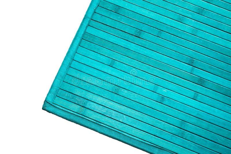 Turkusowy dywanik na bielu obraz stock