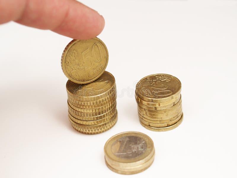 Turm von Euro- und Eurocentmünzen lizenzfreies stockbild