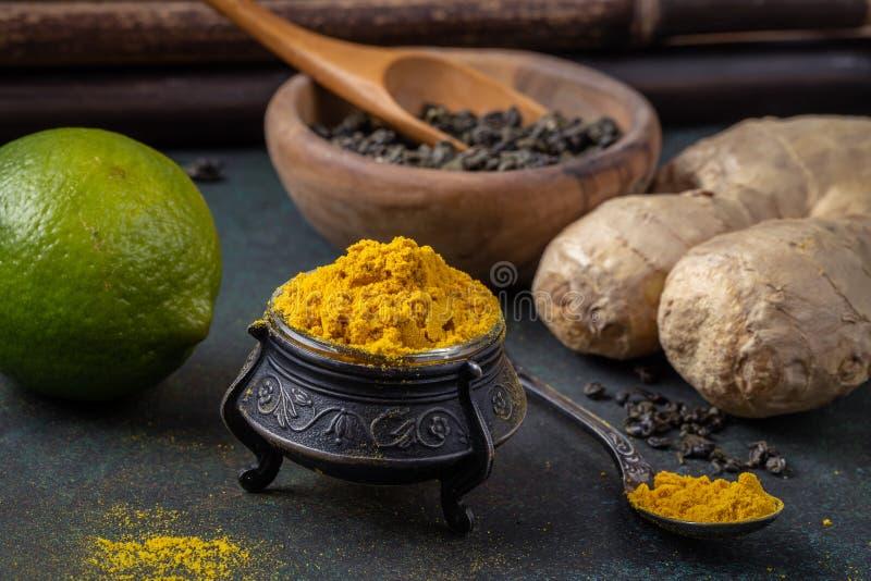 Turmeric based tea ingredients stock photos