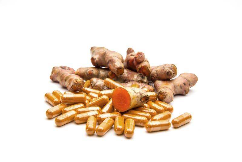 Turmeric Curcuma longa Linn and capsules herbal. royalty free stock images