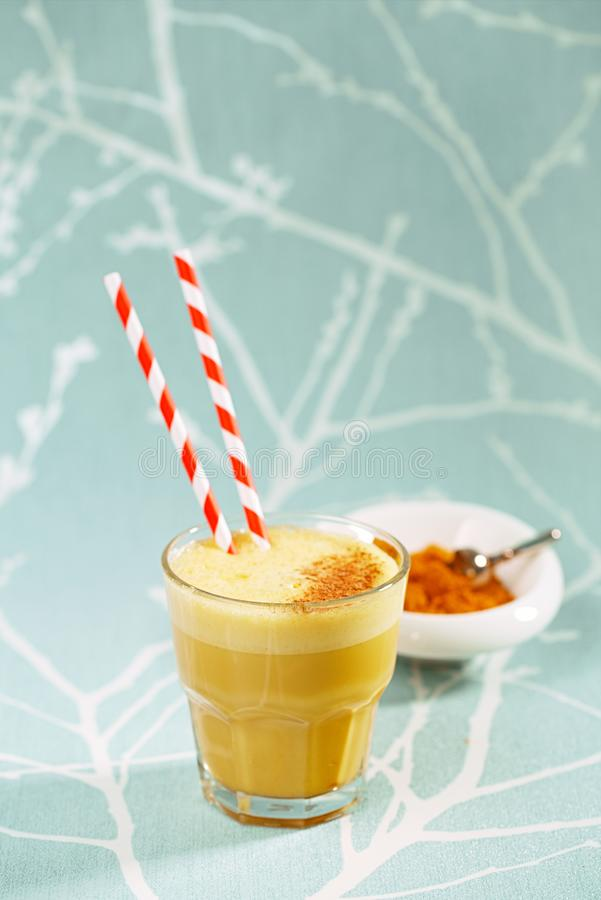 Turmeric latte or golden milk with spice mix royalty free stock photos