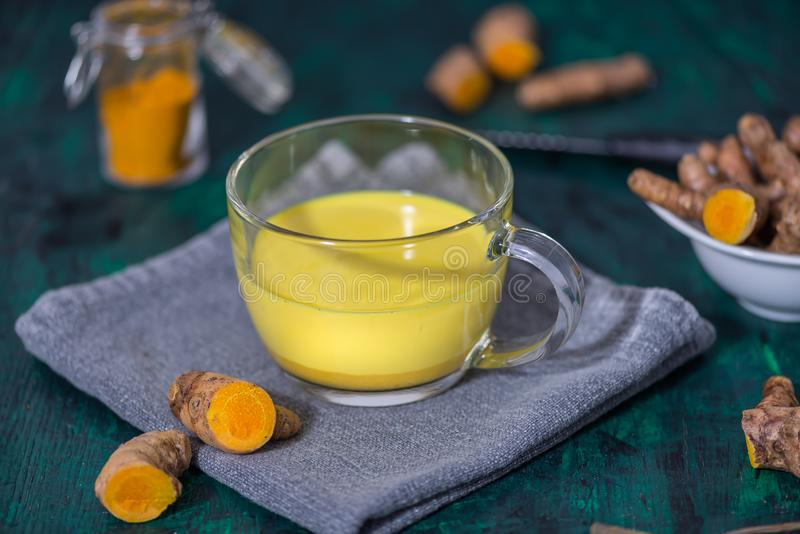 Turmeric Latte and turmeric roots royalty free stock photography