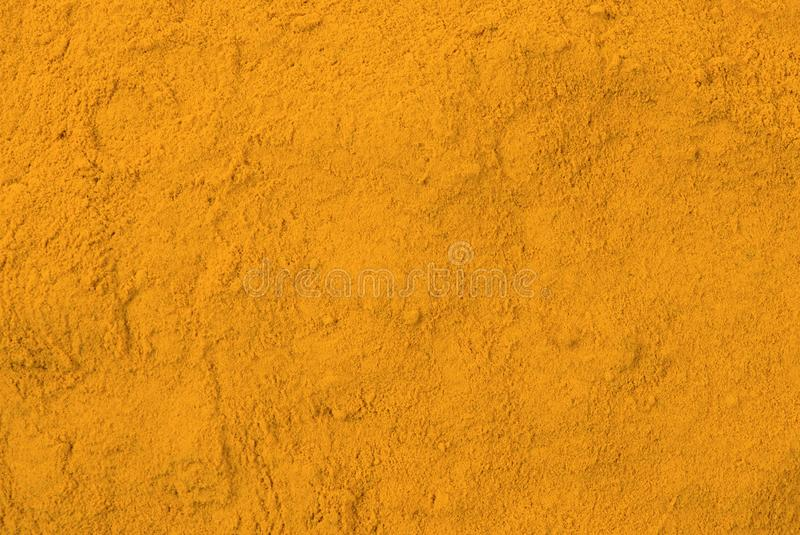 Turmeric powder background. Natural seasoning texture. Natural spices and food ingredients stock photos
