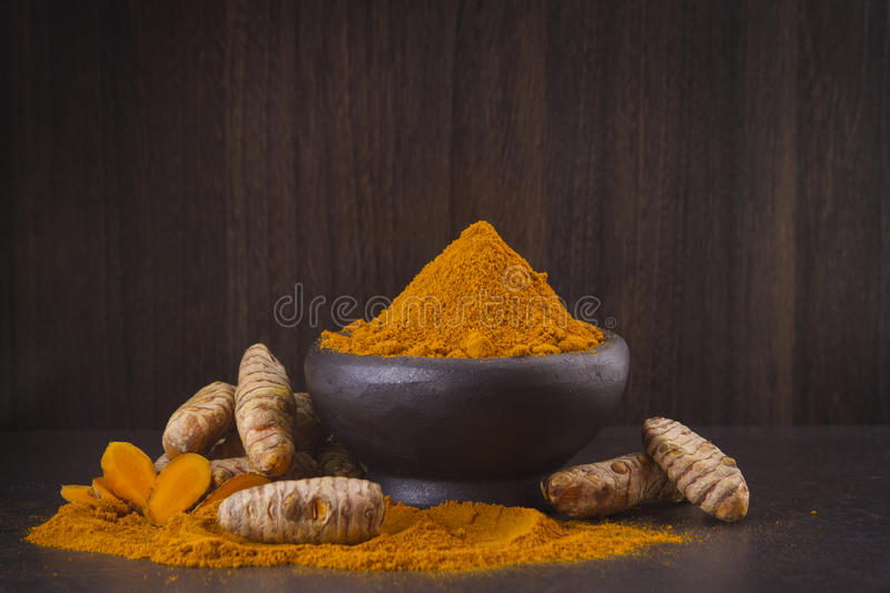 Turmeric In The Bowl On Wooden Background - Cúrcuma Stock