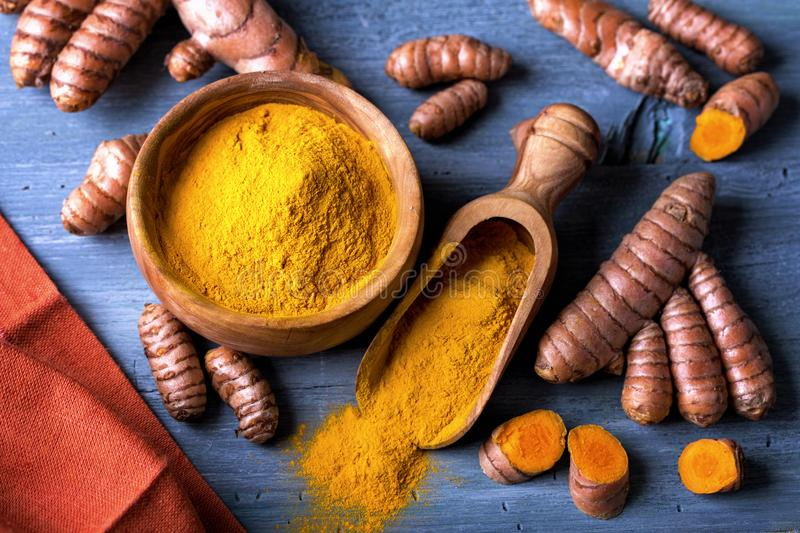 Download Turmeric powder and roots stock image. Image of superfood - 106515155