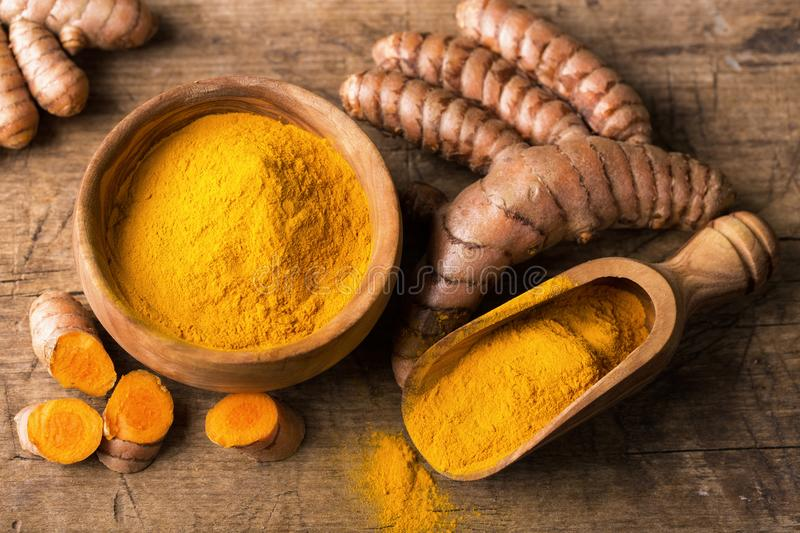 Download Turmeric powder and roots stock photo. Image of healthy - 106514948