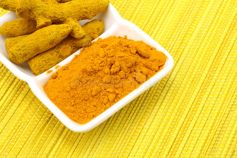 Turmeric powder with turmeric royalty free stock images