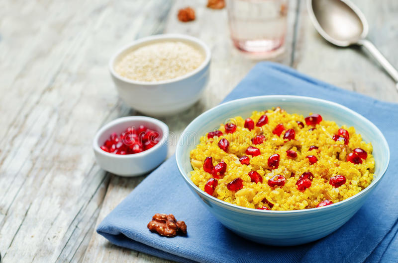 Turmeric quinoa with pomegranate and walnuts. Toning. selective focus stock image