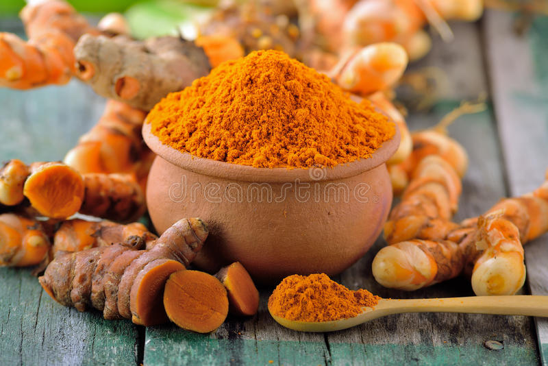 Turmeric roots in the basket stock photos