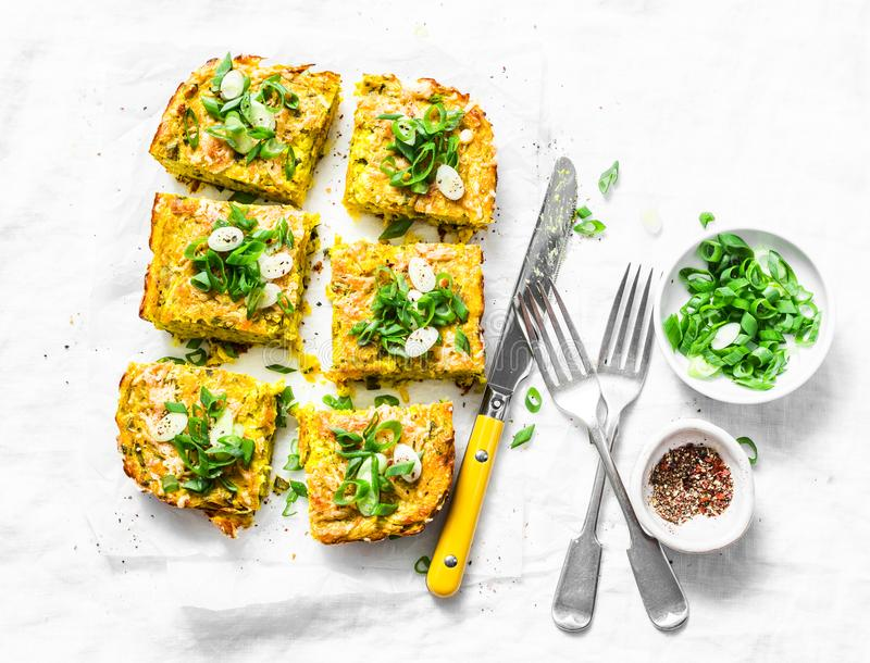 Turmeric, zucchini, mashed chickpeas tortilla with herbs on a light background, top view. Delicious appetizers stock images