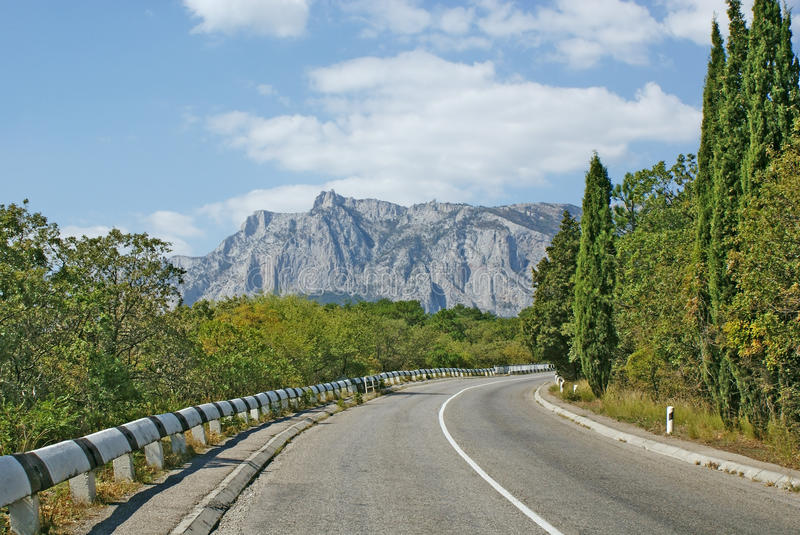 Turn of asphalt road in mountains royalty free stock photo