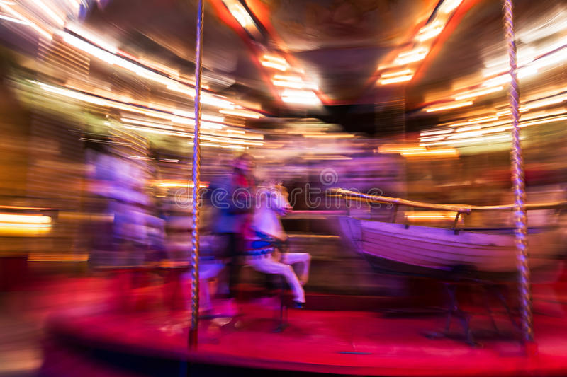 Turn carousel in motion royalty free stock photography