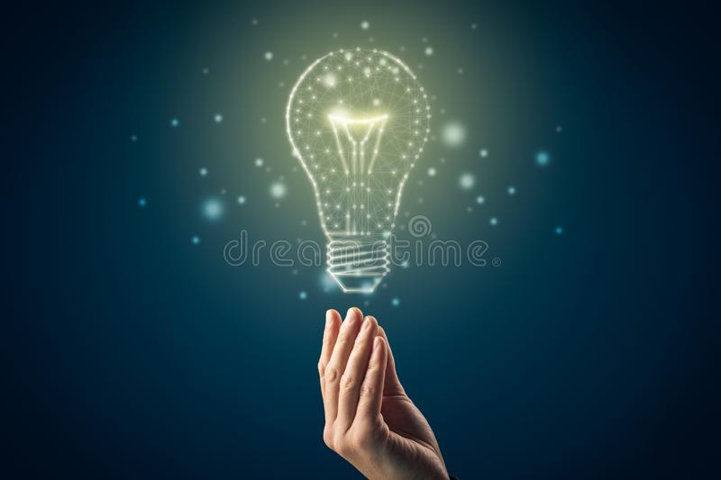 Turn on creativity, idea and intelligence concepts. Hand and graphics light bulb - symbols of idea, creative thinking, innovations and intelligence vector illustration