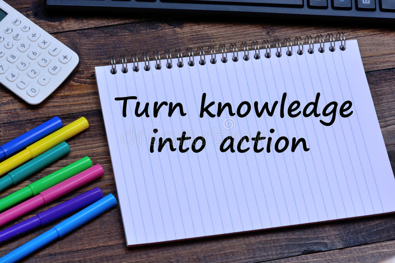Turn knowledge into action words on notebook stock image