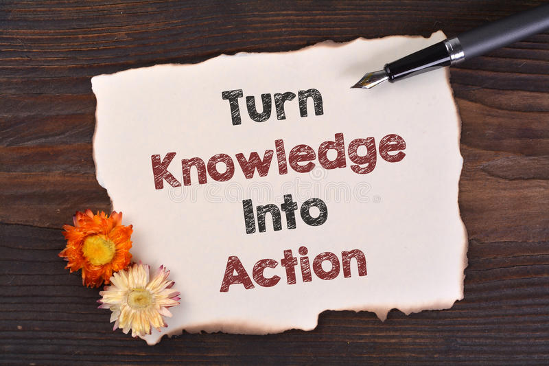 Turn Knowledge Into Action. Writing Turn Knowledge Into Action word stock images