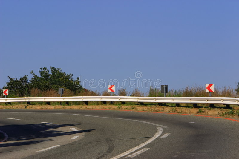 Turn please. Bend in the road, blues sky royalty free stock image