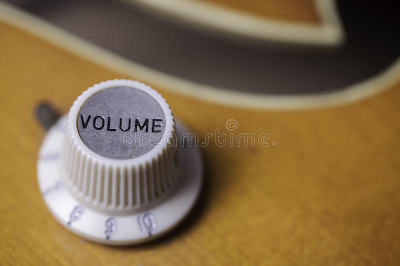 Turn up the volume. Close up of a retro volume control on a vintage guitar stock photo