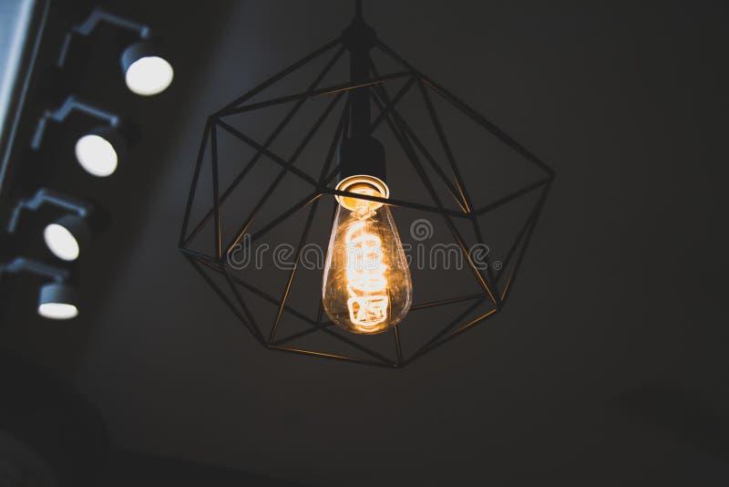 Turned on Black Framed Incandescent Bulb Pendant Lamp royalty free stock photo