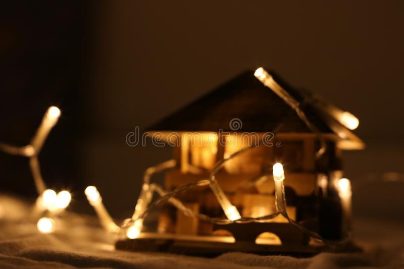 Turned on String Light on Miniature House royalty free stock images