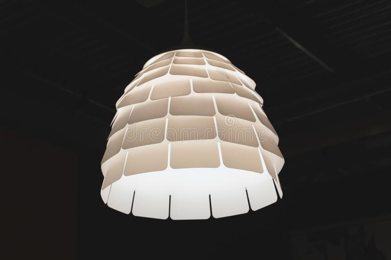 Turned on White Pendant Lamp stock images