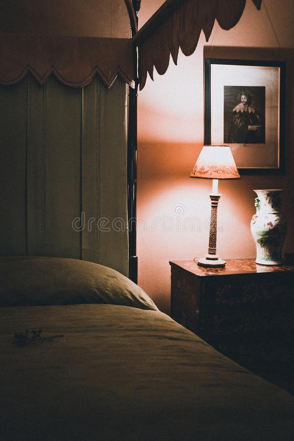 Turned on White Table Lamp royalty free stock photography