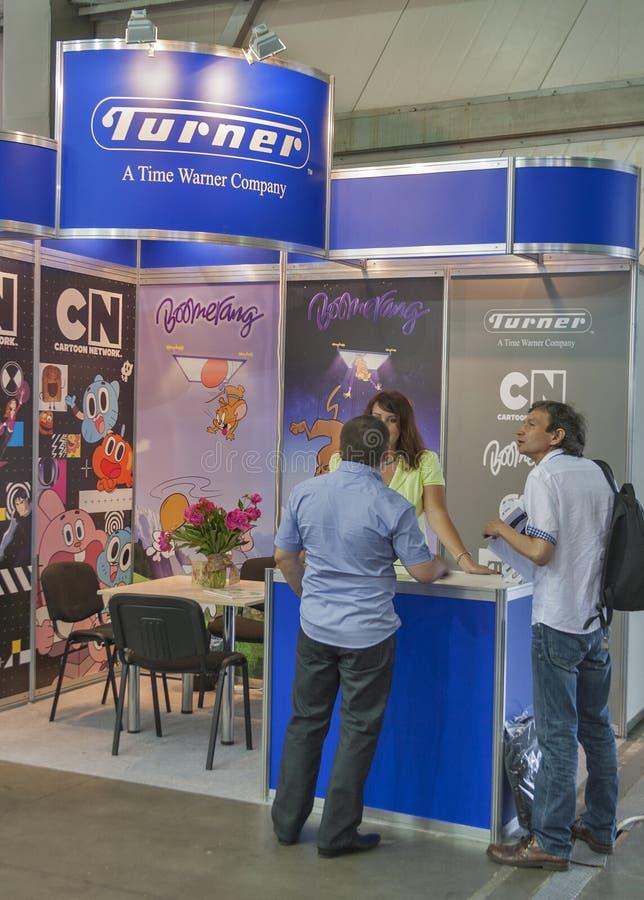 Turner Broadcasting company booth. Visitors visit Turner Broadcasting a Time Warner company booth at Kyiv International TV and Radio Fair 2013 in Kiev, Ukraine stock photo