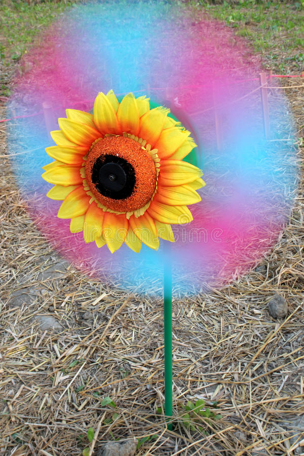 Turning Flower windmill stock images