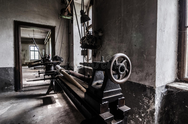 Turning machine in abandoned factory. Detail view royalty free stock images