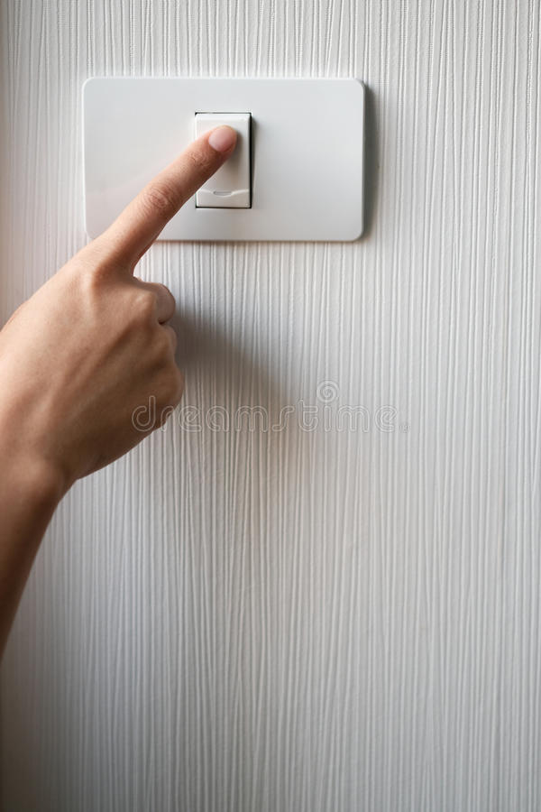 Turning on or off on light switch. Close up of finger is turning on or off on light switch. Copy space royalty free stock images