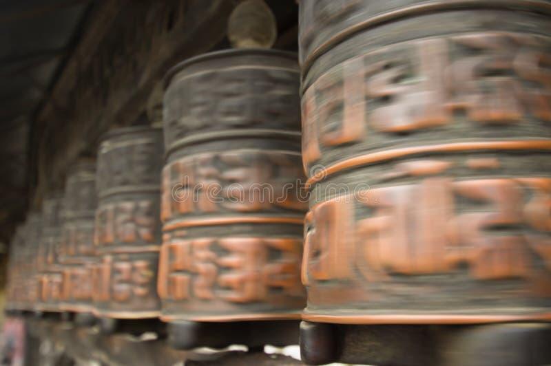 Turning prayer wheels royalty free stock images