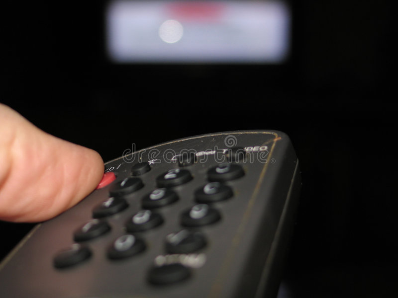 Turning the TV off stock images