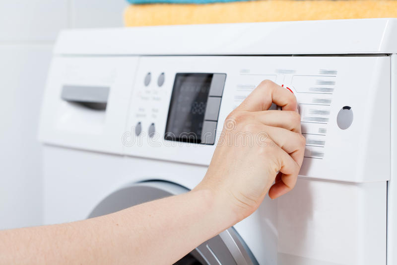 Turning on the washing machine royalty free stock photo