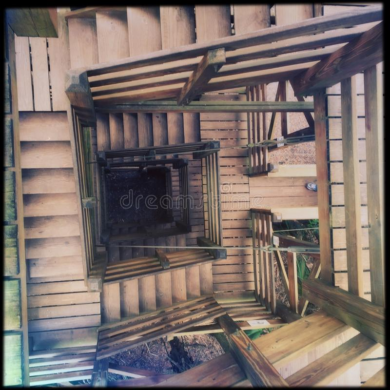Turning wooden staircase royalty free stock photo