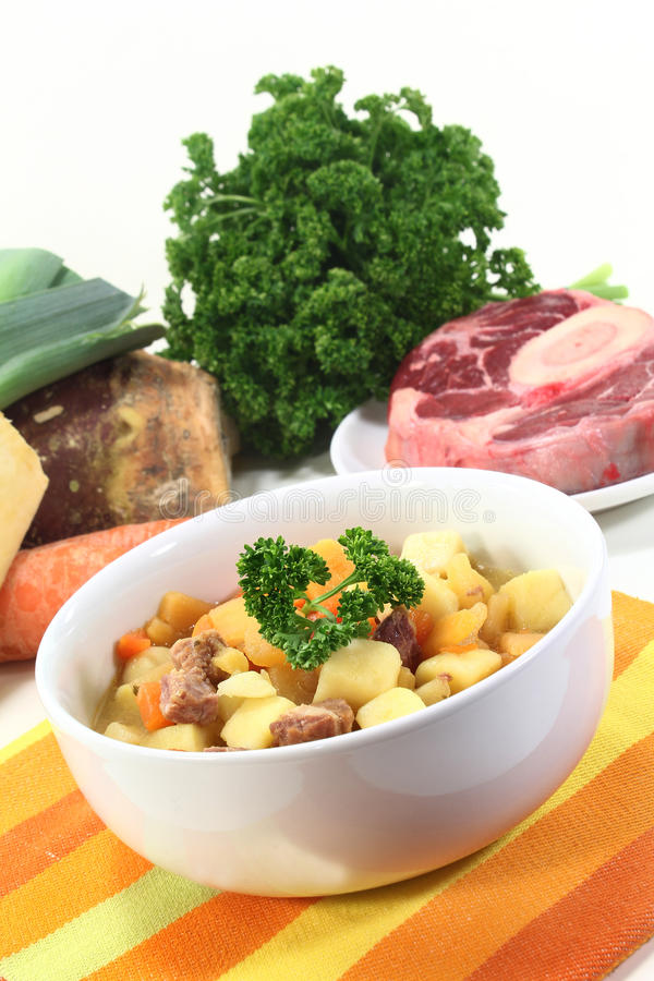 Turnip stew. A bowl of turnip stew with parsley and cook meat stock images