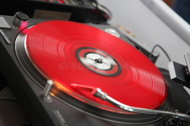 Turntable. Red record on a dj turntable royalty free stock photo