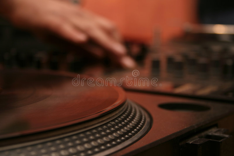 Turntable 2. DJ turntable spinning the record and working the mix stock photos
