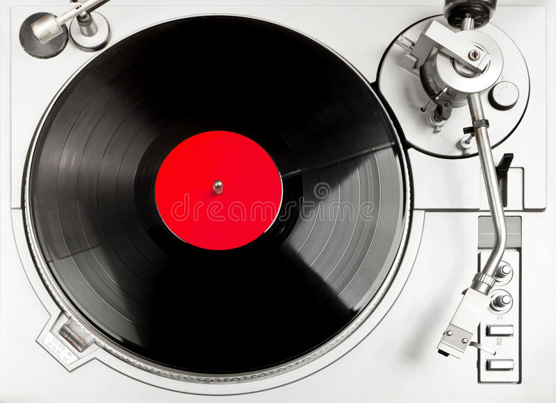 Turntable deck. Turntable - dj's vinyl player with a red vinyl disk on it, view from above royalty free stock images