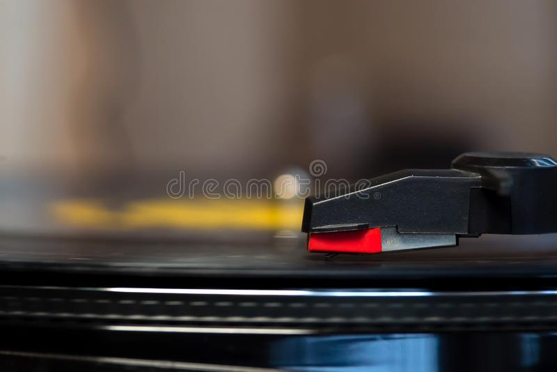 Turntable playing a vinyl. Close up Turntable playing a vinyl record royalty free stock photography